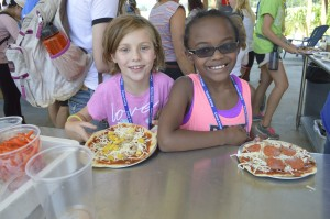 Campers make their own pizzas with fresh ingredients from our garden. The homemade marinara sauce made in the Camp Korey kitchen includes garlic!